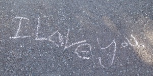I love you written on the sidewalk in chalk --- Image by © Tomas Rodriguez/Corbis
